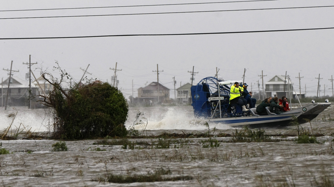Aug. 30, 2012: Plaquemines Parish President Billy Nungesser is seen on an airboat passing Myrtle Grove, background, after Isaac passed through the region, in Plaquemines Parish, La. (AP)  Read more: http://www.foxnews.com/weather/2012/09/01/floodwaters-recede-in-louisiana-leaving-sopping-mess/?test=latestnews#ixzz25Dwa1boe
